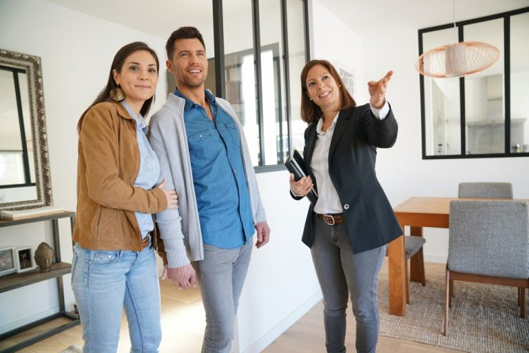 couple doing a house inspection with real estate agent
