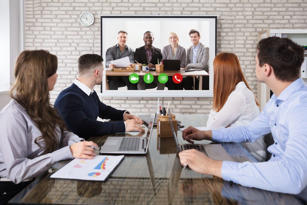 people at a video conference meeting